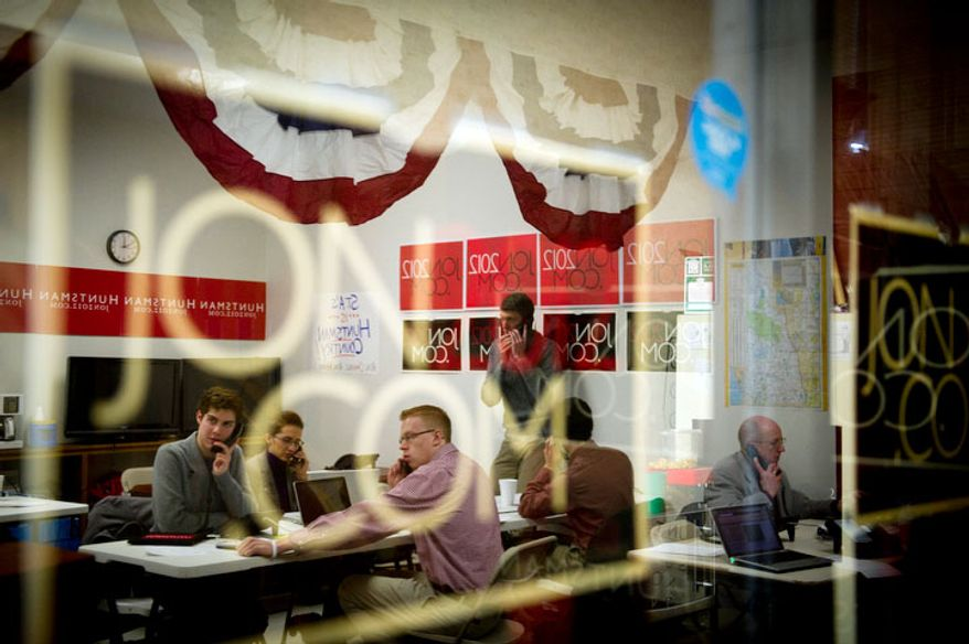 Volunteers for Republican presidential candidate Jon Huntsman work the phones at Huntsman's New Hampshire campaign headquarters in Manchester, NH, Tuesday, January 3, 2012.  (Rod Lamkey Jr/ The Washington Times)