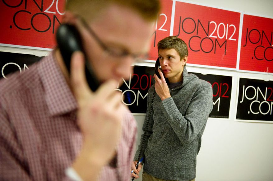 James Linville (right) of New York, NY, and Jake Wagner (left) of Manchester, NH, volunteers for Republican presidential candidate Jon Huntsman, work the phones at Huntsman's New Hampshire campaign headquarters. (Rod Lamkey Jr/ The Washington Times)