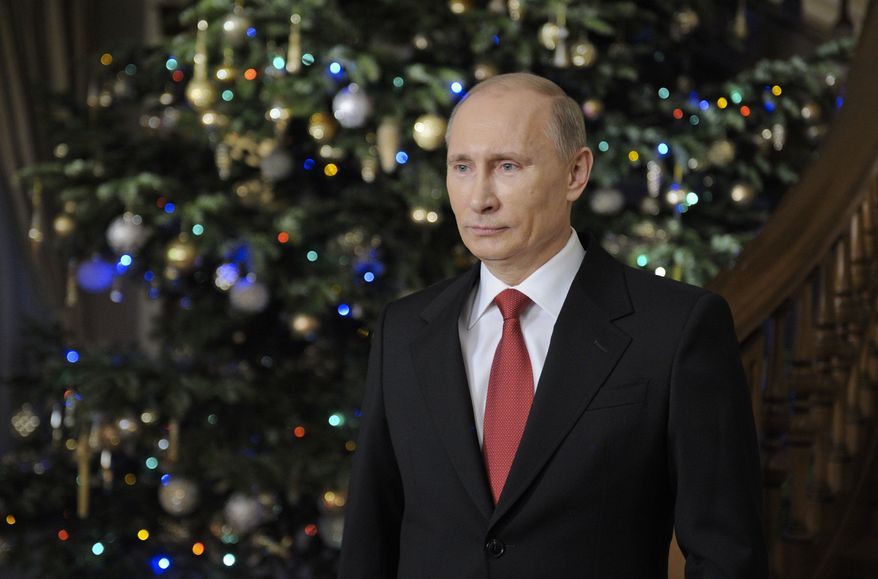 Russian Prime Minister Vladimir Putin wishes Russians a happy New Year during an interview in his residence of Novo-Ogaryovo, outside Moscow, in Russia, Saturday, Dec. 31, 2011. (AP Photo/RIA-Novosti, Alexei Druzhinin, pool)