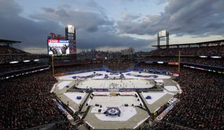 Fans watch the second period of the NHL Winter Classic game between the Philadelphia Flyers and the New York Rangers, Monday, Jan. 2, 2012, in Philadelphia. (AP Photo/Mel Evans)