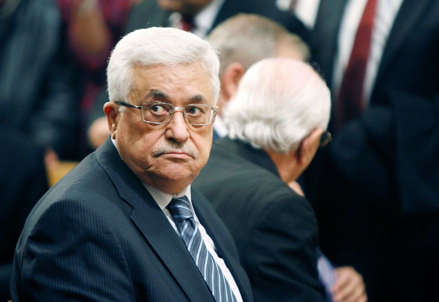 Palestinian President Mahmoud Abbas could pay a heavy price among Palestinians if he returns to formal peace negotiations without an Israeli settlement freeze. (Associated Press)