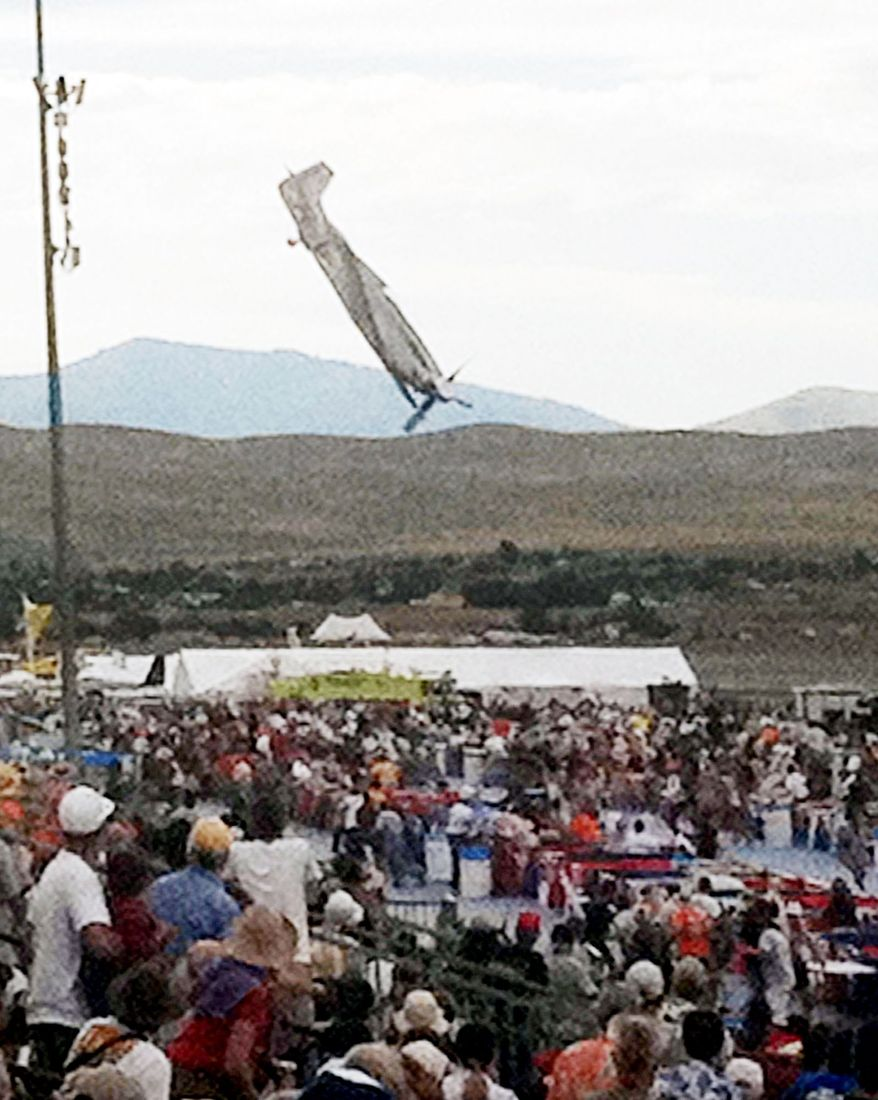 A P-51 Mustang airplane piloted by Jimmy Leeward plunges toward spectators Sept. 16 at the National Championship Air Races. The plane had climbed, rolled and then abruptly plunged nose-first into spectators. Eleven people were killed and more than 70 hurt. (Associated Press)