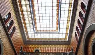New York Gov. Andrew Cuomo and state legislators look at a restored skylight over the Assembly staircase at the Captiol in Albany, N.Y., on Wednesday. He delivered his second State of the State speech at the Empire State Plaza Convention Center. (Associated Press)