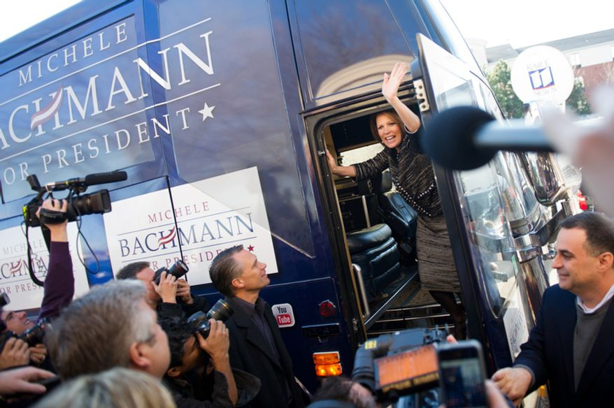 Rep. Michele Bachmann waves from her campaign bus on Wednesday, Jan. 4, 2012, in West Des Moines, Iowa, after announcing she will end her bid for the Republican presidential nomination after finishing sixth in Tuesday's Iowa Republican caucuses. (Andrew Harnik/The Washington Times)
