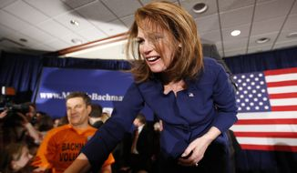 Rep. Michele Bachmann greets supporters after speaking at her caucus party in West Des Moines, Iowa, on Tuesday, Jan. 3, 2012, after finishing sixth in the Iowa's Republican presidential caucuses. (AP Photo/Des Moines Register, Justin Hayworth)