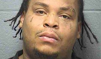 Exulam Holman, 32, was arrested Jan. 4, 2012, on a charge of aggravated domestic battery on Dec. 31, 2011, when he is accused of gouging his 62-year-old uncle's eyes out during a fight over a remote control. (Associated Press/Will County Sheriff's Office)