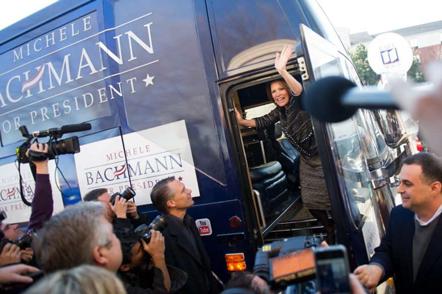 Rep. Michele Bachmann waves goodbye to supporters as she boards her campaign bus on Wednesday, Jan. 4, 2012, in West Des Moines, Iowa, after announcing she will end her campaign for president. (Andrew Harnik/The Washington Times)