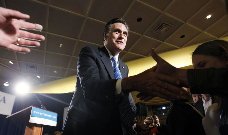 Former Massachusetts Gov. Mitt Romney greets supporters at his caucus night rally in Des Moines, Iowa, on Tuesday, Jan. 3, 2012. (AP Photo/Charles Dharapak)