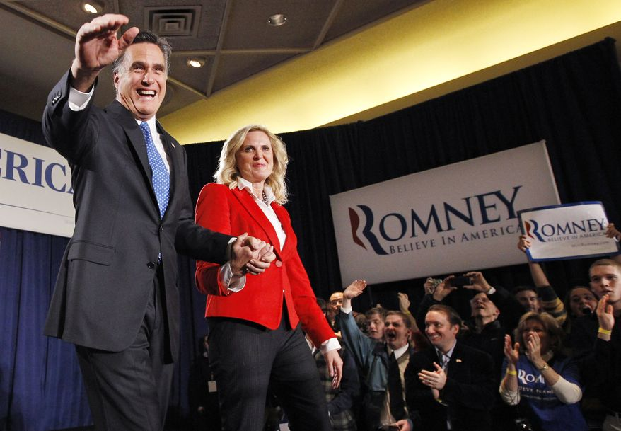 Republican presidential candidate and former Massachusetts Gov. Mitt Romney takes the stage Jan. 3, 2012, with his wife Ann at his caucus night rally in Des Moines, Iowa. (Associated Press)