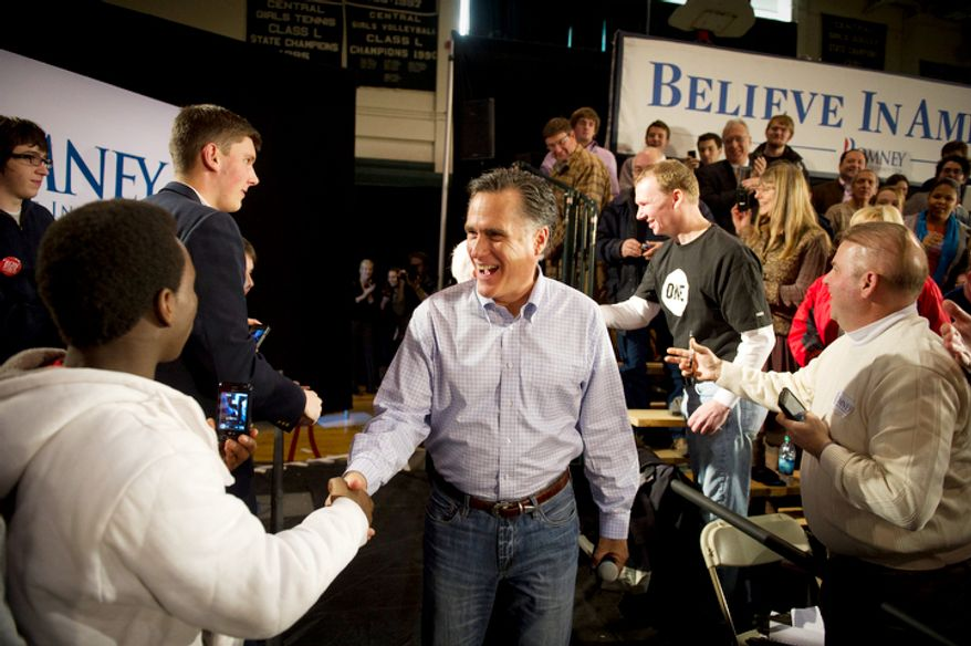 With less than a week before the nation's first presidential primary, former Massachusetts Gov. Mitt Romney arrives on a GOP presidential campaign stop at Manchester Central High School in Manchester, N.H., on Wednesday, Jan. 4, 2012. (Rod Lamkey Jr./The Washington Times)