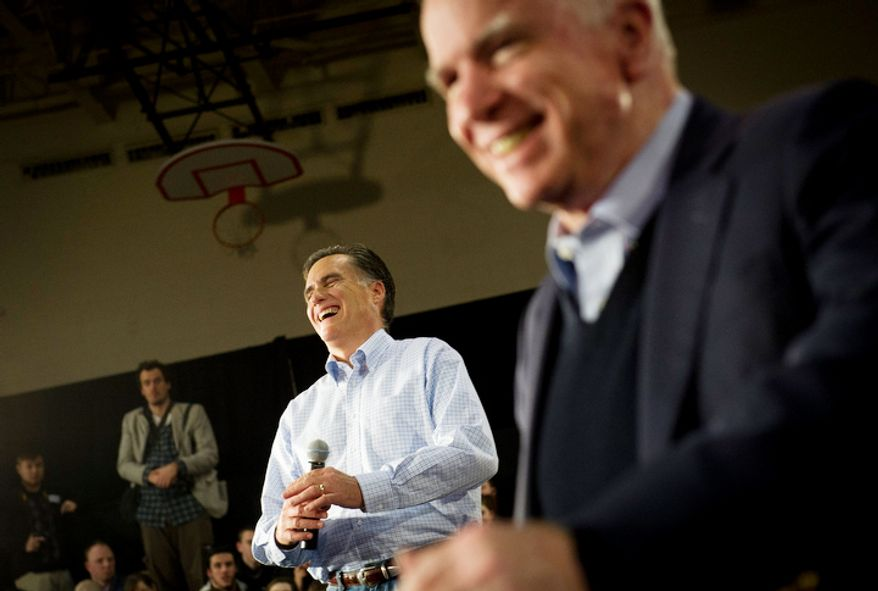 Former Massachusetts Gov. Mitt Romney (left) laughs with Sen. John McCain during a town-hall meeting in Manchester, N.H., on Wednesday, Jan. 4, 2012. The Arizona senator endorsed Mr. Romney for the Republican presidential nomination. (Rod Lamkey Jr./The Washington Times)
