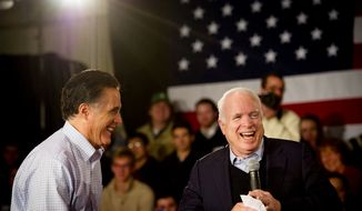 Former Massachusetts Gov. Mitt Romney and Sen. John McCain share a laugh at a town-hall meeting at Manchester Central High School in Manchester, N.H., on Wednesday, Jan. 4, 2012. (Rod Lamkey Jr./The Washington Times)