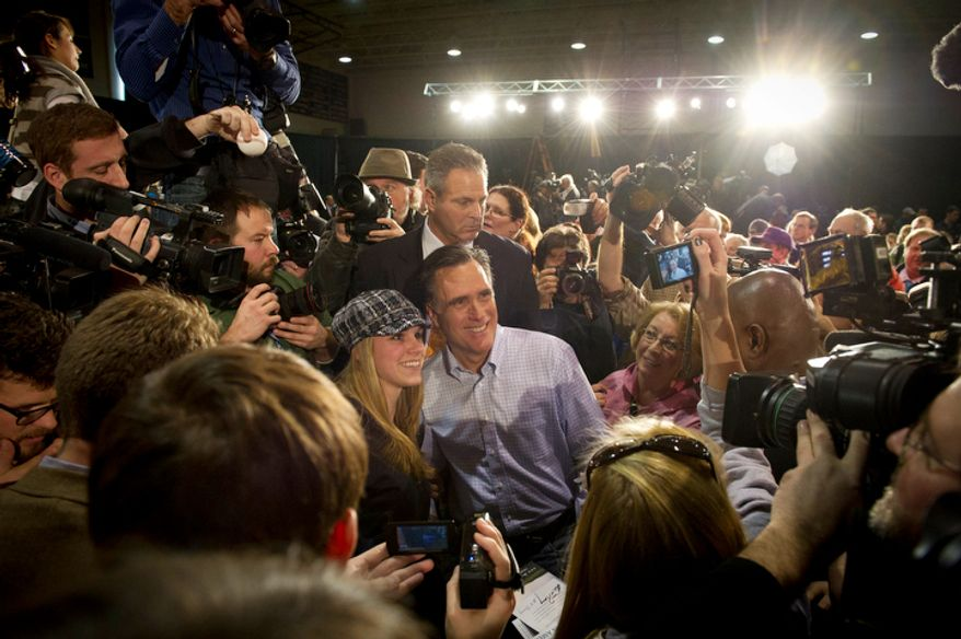 Former Massachusetts Gov. Mitt Romney takes photos with and meets supporters following a GOP presidential campaign stop at Manchester Central High School in Manchester, N.H., on Wednesday, Jan. 4, 2012. (Rod Lamkey Jr./The Washington Times)
