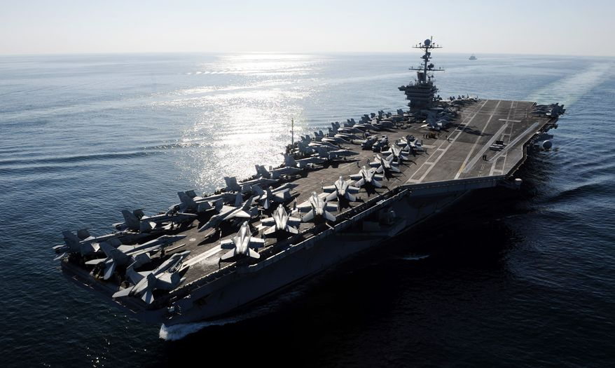 The Nimitz-class aircraft carrier USS John C. Stennis transits the Straits of Hormuz on Saturday, Nov. 12, 2011. (AP Photo/U.S. Navy, Petty Officer 3rd Class Kenneth Abbate)