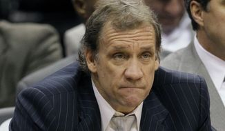 Washington Wizards coach Flip Saunders watches the final minutes of the game against the Orlando Magic on Wednesday, Jan. 4, 2012, in Orlando, Fla. Orlando won 103-85. (AP Photo/John Raoux)