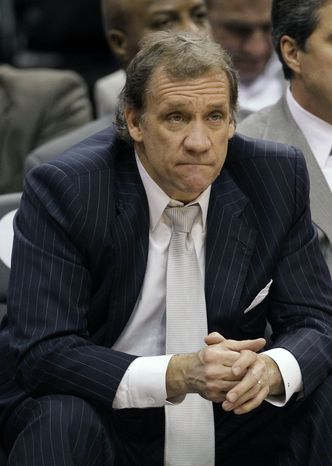Washington Wizards coach Flip Saunders watches the final minutes of the game against the Orlando Magic on Wednesday, Jan. 4, 2012, in Orlando,
