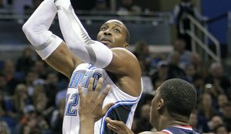 Orlando Magic center Dwight Howard shoots over Washington Wizards' Kevin Seraphin during the second half Wednesday, Jan. 4, 2012, in Orlando, Fla. Orlando won 103-85, as Howard had 28 points, 20 rebounds and three blocks. (AP Photo/John Raoux)