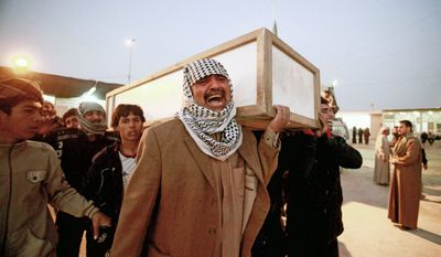 Relatives carry the coffin of Rasha Hassan, 22, before her burial in the Shiite holy city of Najaf, 160 kilometers (100 miles) south of Baghdad, Iraq, Thursday, Jan. 5, 2012. A wave of explosions struck two Shiite neighborhoods on Thursday, killing and injuring dozens of Iraqis, police said, and intensifying fears that insurgents are stepping up attacks after the U.S. troop withdrawal that was completed last month. (AP Photo/Alaa al-Marjani)