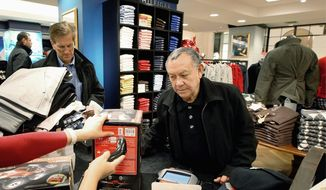 Jesus Esparza of Chicago was shopping at the Macy's on State Street in Chicago two weeks before Christmas, one of many Americans finding bargains that helped their checkbooks but hurt a lot of retailers' bottom lines. Macy's Inc., however, saw strong gains in December that beat analysts estimates. (Associated Press)