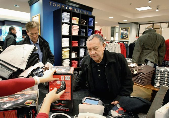 Jesus Esparza of Chicago was shopping at the Macy's on State Street in Chicago two weeks before Christmas, one of many Americans finding bargains that helped their checkbooks but hurt a lot of retailers' bottom lines. M