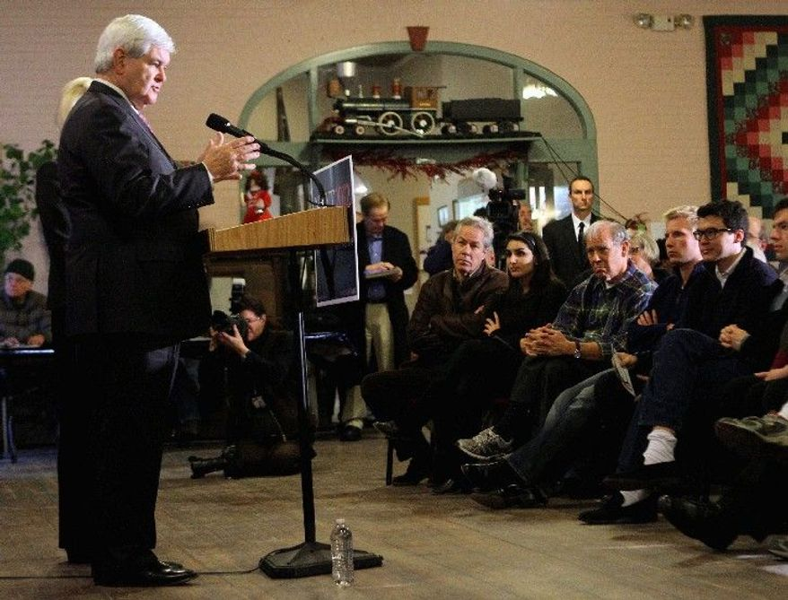 Republican presidential hopeful Newt Gingrich campaigns at the Plymouth Senior Center on Thursday in Plymouth, N.H. With the New Hampshire GOP primary just days away on Jan. 10, the former House speaker is contrasting the front-runner's record with his own. (Associated Press)