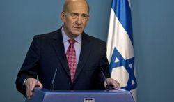 ** FILE ** Then-Israeli Prime Minister Ehud Olmert gives a statement to the media at his Jerusalem office in March 2009. (AP Photo/Sebastian Scheiner, File)