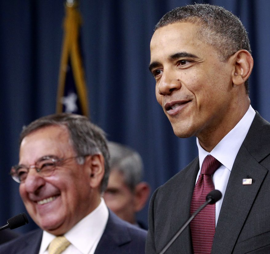 President Obama (right) and Defense Secretary Leon E. Panetta share a laugh with the press corps after the president spoke on the Defense Strategic Review on Thursday, Jan. 5, 2012, at the Pentagon in Arlington. (AP Photo/Haraz N. Ghanbari)