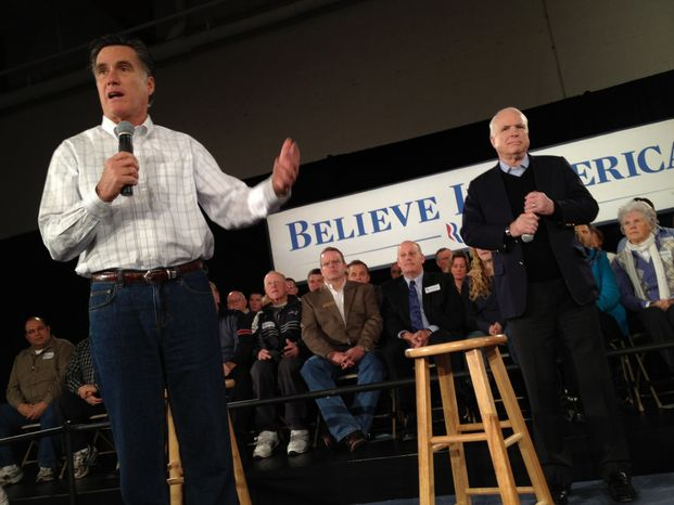 Former Massachusetts Gov. Mitt Romney (left), accompanied by Sen. John McCain, Arizona Republican, campaigns for the GOP presidential nomination at the Boys and Girls Club in Salem, N.H., on Thursday, Jan. 5, 2012. (AP Photo/Charles Dharapak)