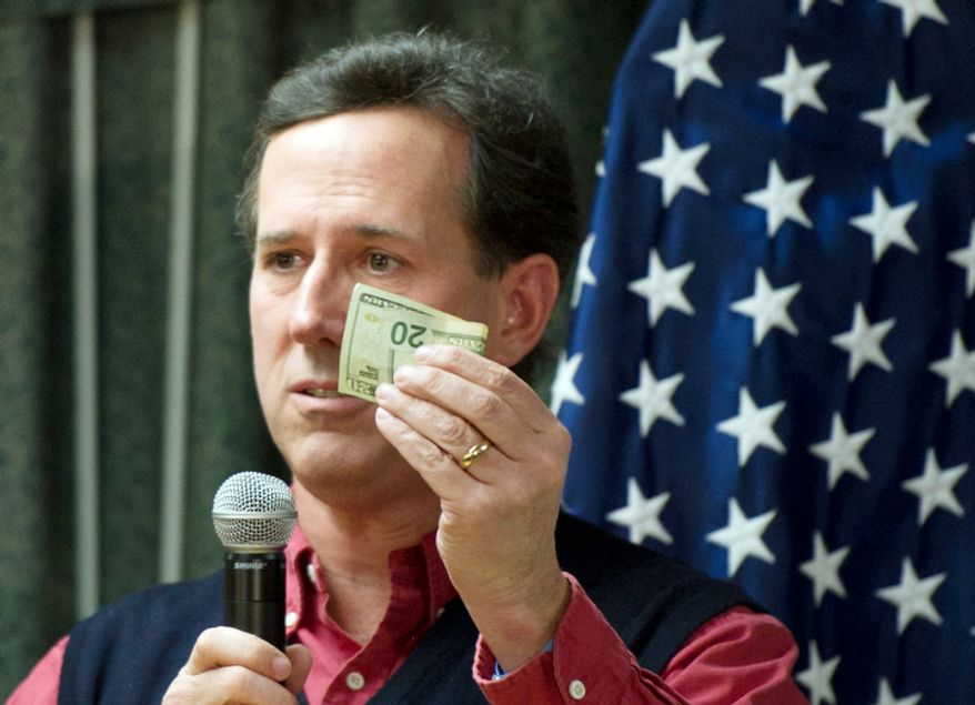 """Republican presidential candidate and former Pennsylvania Senator Rick Santorum talks about the social security surplus during his speech to a mixed crowd of younger and older people, for a """"Faith, Family and Freedom"""" town hall meeting at the Rockingham County Nursing Home Hilton Auditorium in Brentwood, NH, Wednesday, January 4, 2012. (Rod Lamkey Jr/ The Washington Times)"""