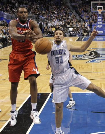 Washington Wizards' Trevor Booker and Orlando Magic's Ryan Anderson vie for a rebound during the second half Wednesday, Jan. 4, 2012, in Orlando, Fla. Orlando won 103-85. (AP Photo/John Raoux)