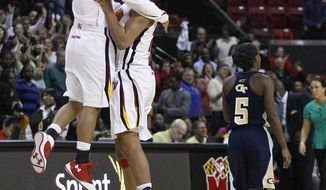 Maryland guard Sequoia Austin, left, celebrates with teammate Alyssa Thomas as Georgia Tech guard Metra Walthour (5) walks off the court after Maryland beat Georgia Tech 77-74 in College Park, Md., Friday, Jan. 6, 2012. Thomas contributed a game-high 24 points. (AP Photo/Patrick Semansky)