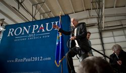 With just four days before the nation's first presidential primary in New Hampshire, Republican presidential candidate and U.S. Rep. Ron Paul R-TX, delivers his speech to a large crowd during a campaign stop at Nashua Jet Aviation at Biore Field Airport in Nashua, NH, Friday, January 6, 2012. (Rod Lamkey Jr/ The Washington Times)