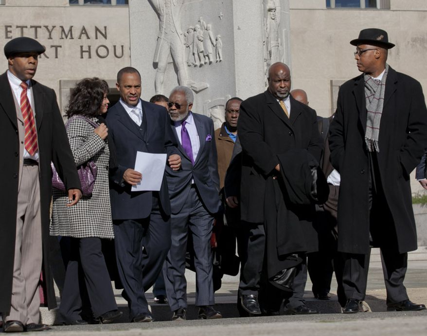 Former D.C. Council member Harry Thomas Jr., 51, and his family exit the U.S. District Courthouse in D.C., on Jan. 6, 2012, after Thomas pleaded guilty to felony counts of stealing more than $350,000 in taxpayer funds and failing to report income on his tax returns. (Andrew S. Geraci/The Washington Times)