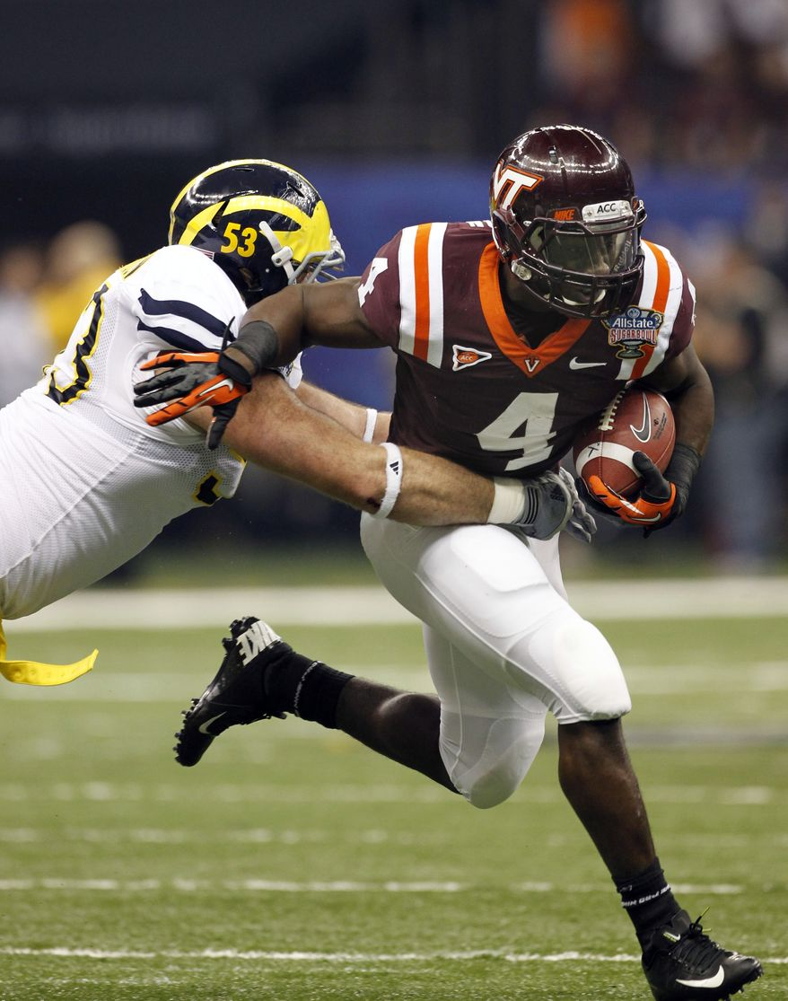 FILE - In this Tuesday Jan. 3, 2011 file photo Virginia Tech running back David Wilson (4) carries as Michigan defensive end Ryan Van Bergen (53) tries to tackle during the first quarter of the Sugar Bowl NCAA college football game in New Orleans. Wilson says he'll skip his senior season and enter the NFL draft. (AP Photo/Dave Martin)