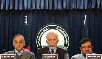 Gul Rahman Qazi, center, head of an Afghan investigative commission speaks during a media conference in Kabul, Afghanistan, Saturday, Jan. 7, 2012. Afghan President Karzai had charged the commission with investigating the detention of some hundreds of suspected militants and the investigative commission has accused the U.S. military of abusing detainees at its largest prison. (AP Photo/Musadeq Sadeq)