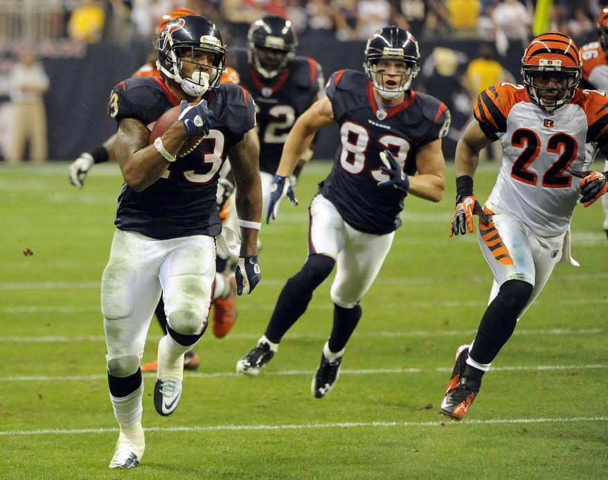 Houston Texans running back Arian Foster (23) runs for a touchdown against the Cincinnati Bengals during the fourth quarter of the Wild Card playoff football game Saturday, Jan. 7, 2012, in Houston. (AP Photo/Dave Einsel)