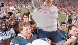 FILE - In this Jan. 25, 1987, file photo, New York Giants coach Bill Parcells is carried off the field after the Giants defeated the Denver Broncos 39-20 in SuperBowl XXI NFL football game in Pasadena, Calif. Parcells moved one step closer to Canton on Saturday, Jan. 7, 2012, when the Pro Football Hall of Fame released a list of 15 modern-era finalists for enshrinement that included the Super Bowl-winning coach. (AP Photo/Eric Risberg, File)