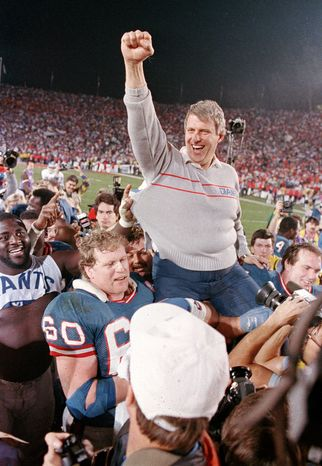 FILE - In this Jan. 25, 1987, file photo, New York Giants coach Bill Parcells is carried off the field after the Giants defeated the Denver Broncos 39-20 in SuperBowl XXI NFL football game in Pasadena, Calif. Parcells moved one step closer to Canton on Saturday, Jan. 7, 2012, when the Pro Football Hall of Fame re