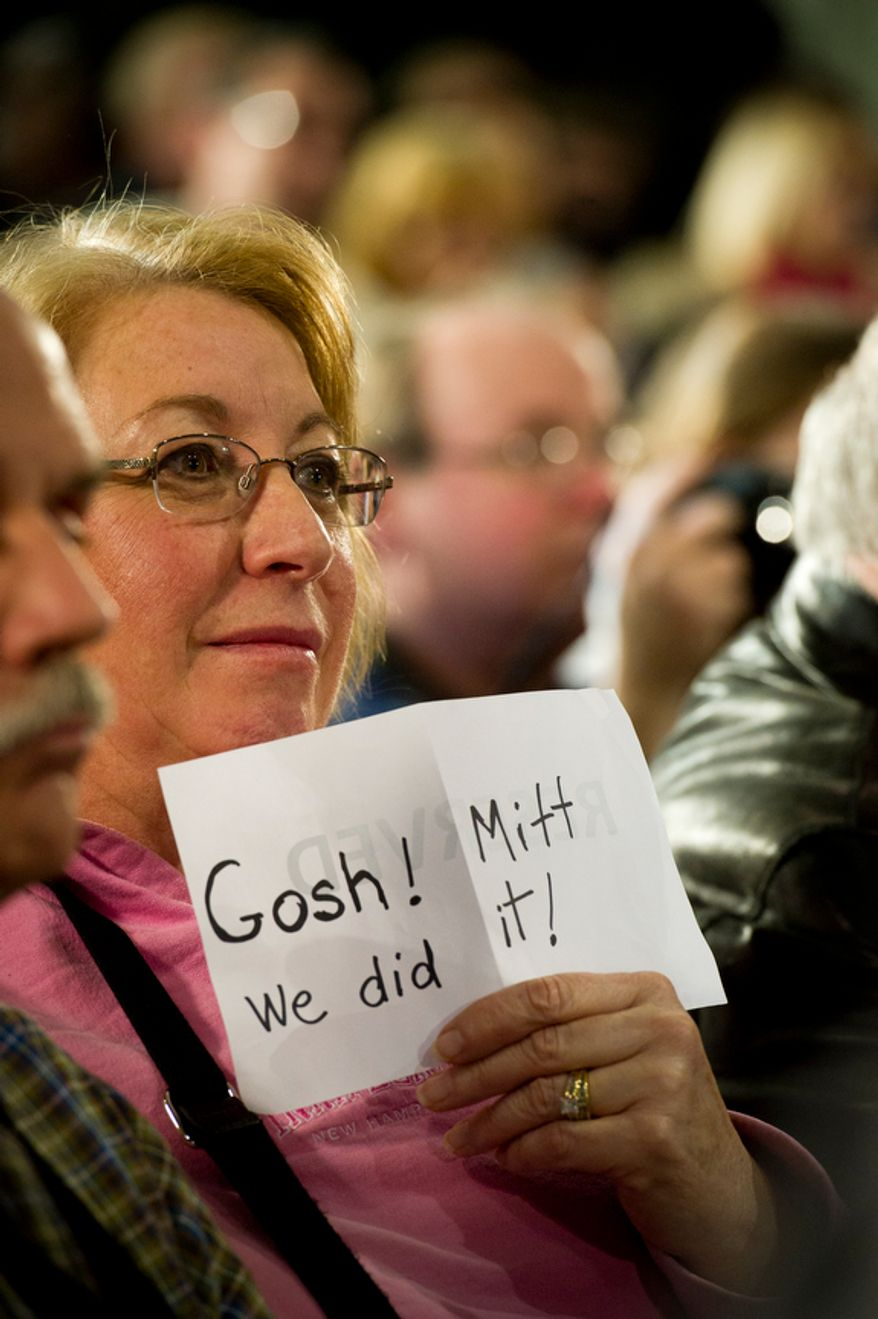 Susan Mielbrecht of Moultonborough, NH, holds a hand made sign as she sits in the audience while Republican presidential candidate and former Massachusetts governor Mitt Romney is joined by Sen. John McCain R-AZ as he gets the endorsement of Sen. McCain at a townhall meeting at Manchester Central High School in Manchester,NH, Wednesday, January 4, 2012. (Rod Lamkey Jr/ The Washington Times)
