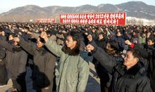 In this Jan. 6, 2012, photo released by the Korean Central News Agency and distributed in Tokyo by the Korea News Service, North Korean farmers hold a rally in support for the country's Worker's Party policies in Nampo, North Korea. (AP Photo/Korean Central News Agency via Korea News Service)