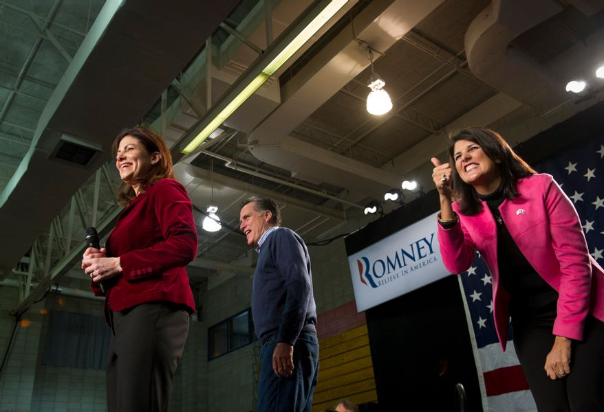 Republican presidential candidate and former Massachusetts Governor Mitt Romney is joined on stage by Sen. Kelly Ayotte R-NH (left) and South Carolina Governor Nikki Haley (R) (right) as they introduce him to the crowd at the Pinkerton Academy in Derry, NH, Saturday, January 7, 2012. (Rod Lamkey Jr/ The Washington Times)