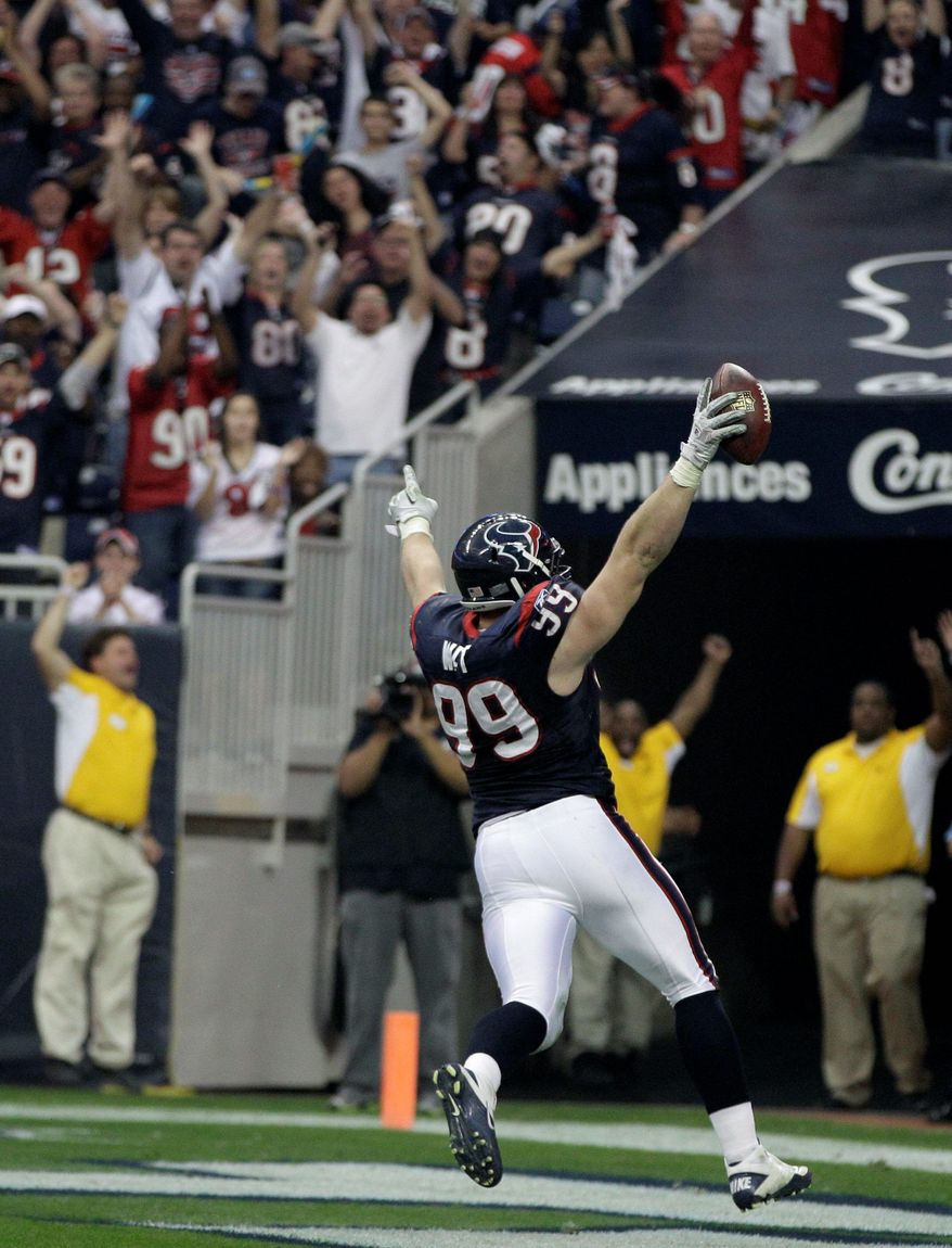 ASSOCIATED PRESS Houston defensive end J.J. Watt scores on an interception during the last minute of the first half. The play catapulted the Texans to a 31-10 victory Saturday.