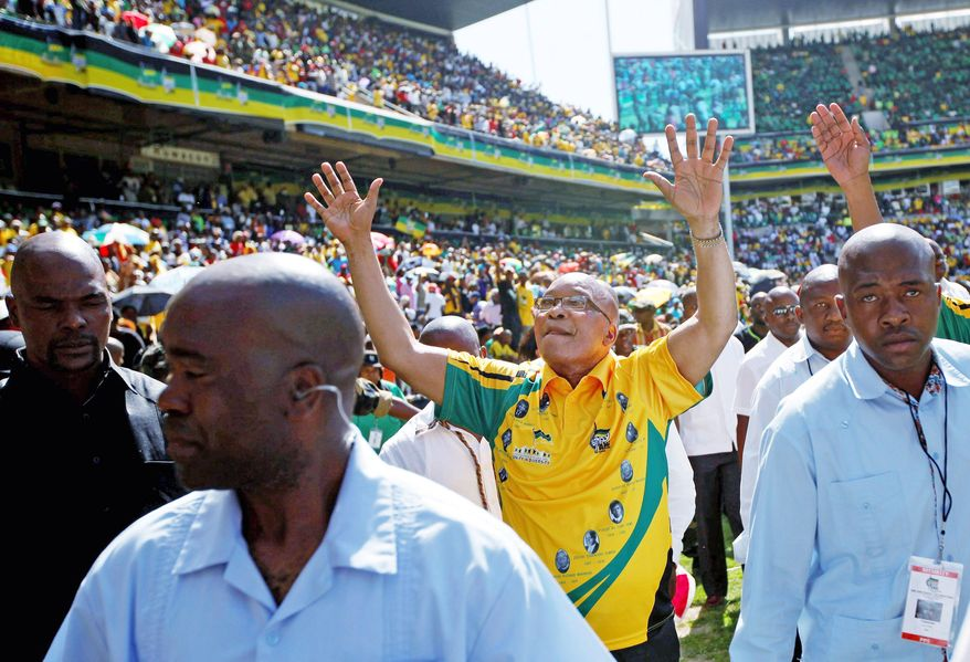 South African President Jacob Zuma acknowledges those gathered for the African National Congress' 100th anniversary festivities Sunday in Bloemfontein. Although tens of thousands celebrated, many South Africans say Nelson Mandela's party hasn't delivered on its promises since taking power in 1994. (Associated Press)