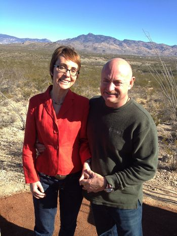 Rep. Gabrielle Giffords and husband Mark Kelly pose at the Davidson Canyon Gabe Zimmerman Memorial trailhead outside Tucson, Ariz., on Saturday, Jan. 7, 2012. The trailhead is named in honor of Mrs. Giffords' slain staff member Gabe Zimmerman. (AP Photo/Office of Rep. Gabrielle Giffords)