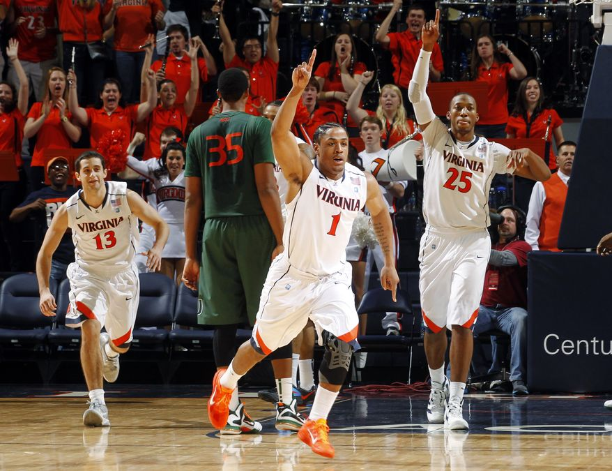 Virginia celebrates as the clock expires at the end of their 52-51 win against Miami, Saturday, Jan. 7, 2012, in Charlottesville, Va. (AP Photo/Andrew Shurtleff)