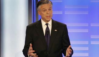 Former Utah Gov. Jon Huntsman answers a question during a Republican presidential debate at St. Anselm College in Manchester, N.H., on Saturday, Jan. 7, 2012. (AP Photo/Elise Amendola)