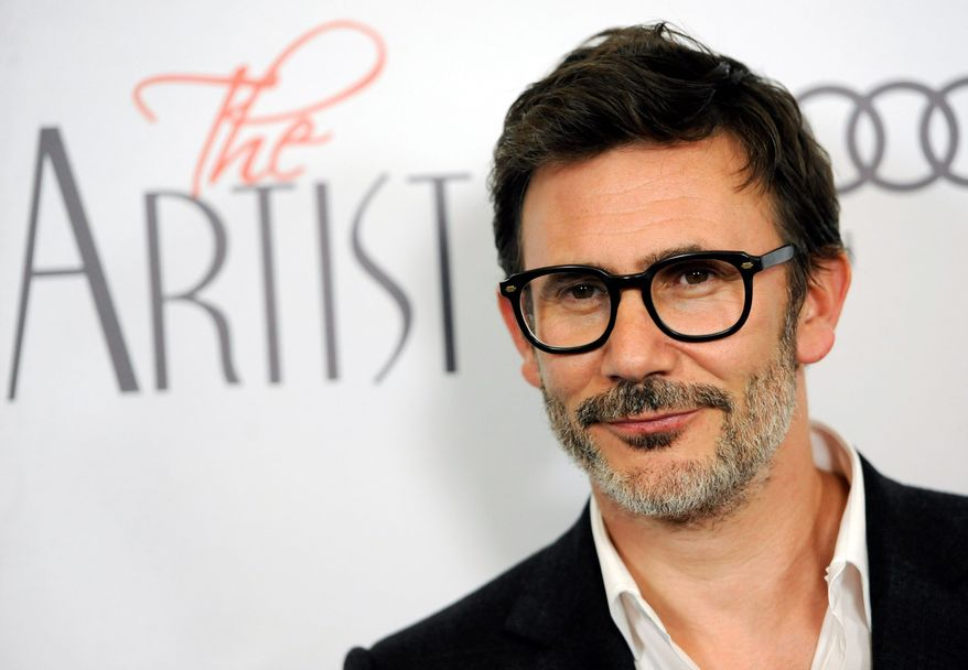 "Michel Hazanavicius has emerged as the front-runner for the Directors Guild of America's top prize after directing ""The Artist,"" a black-and-white silent film. (Associated Press)"