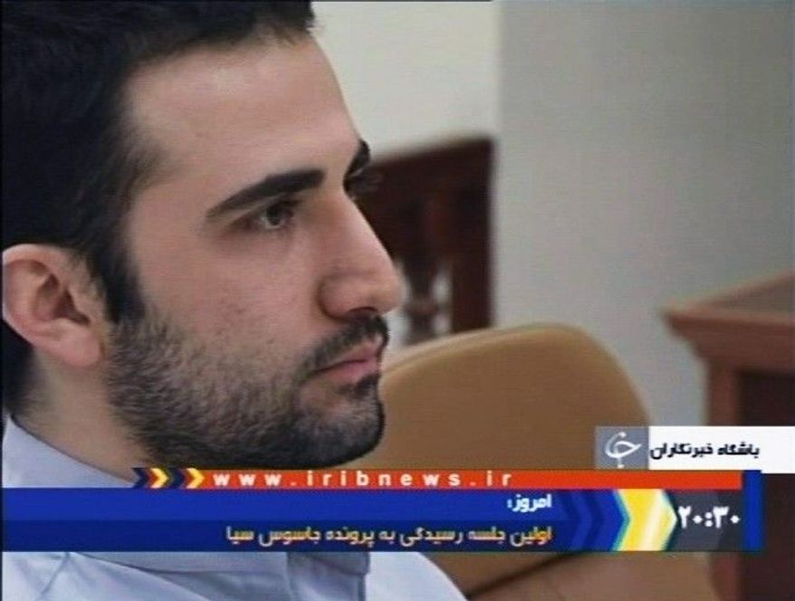In a video image made from Iran's IRIB-TV, U.S. citizen Amir Mirzaei Hekmati, accused by Iran of spying for the CIA, sits in Tehran's revolutionary court. An Iranian court has convicted Mr. Hekmati and sentenced him to death, state radio reported Monday. Mr. Hekmati is of Iranian descent and a former Marine. (Associated Press)