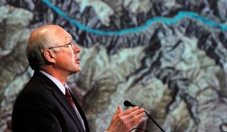 ** FILE ** Interior Secretary Kenneth L. Salazar stands in front of a map of the Grand Canyon as he announces a 20-year ban on new mining claims. (Associated Press)