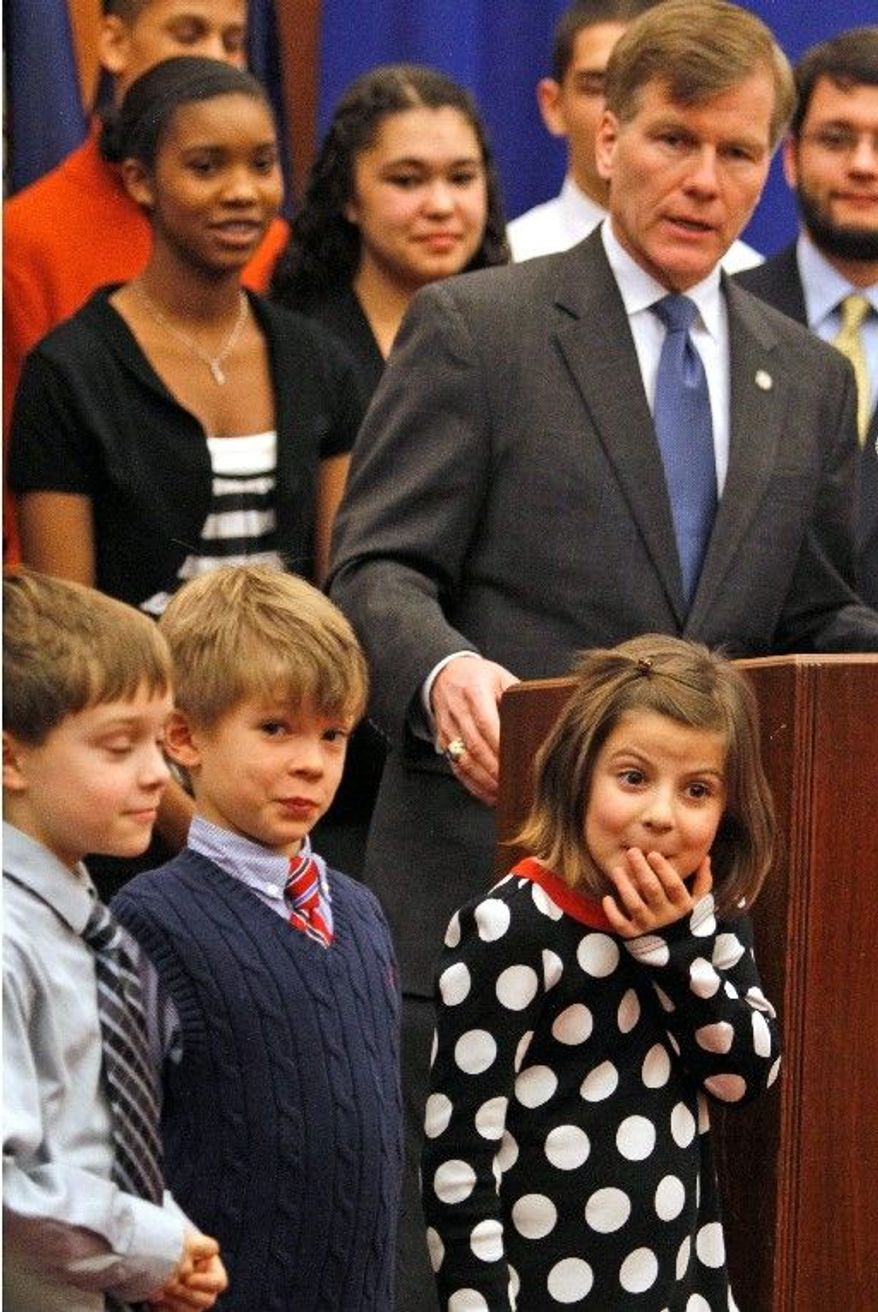 Virginia Gov. Bob McDonnell announces his education agenda Monday for the legislature at the Capitol in Richmond as (from left) Luca Rickey, Zane Childress and Caroline Saady listen. His No. 1 push will be to repeal the so-called Kings Dominion law that says schools cannot open until after Labor Day. (Associated Press)